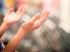 Faith-Christian-hands-pray-praise-worship_credit-Shutterstock