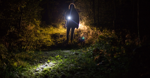 person-holding-flashlight-during-nighttime-1444860
