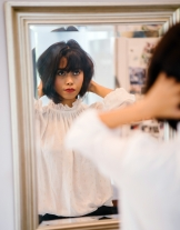 selective-focus-photography-of-woman-in-front-of-mirror-1476291