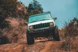 white-jeep-suv-cruising-down-the-road-912843
